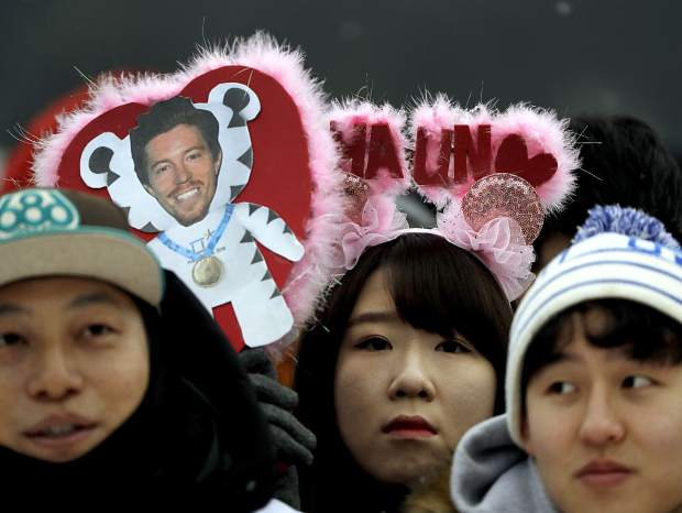 Fans hold an image of Shaun White, of the United States, prior to the start of the men's halfpipe finals at Phoenix Snow Park at the 2018 Winter Olympics in Pyeongchang, South Korea, Wednesday, Feb. 14, 2018. (AP Photo/Gregory Bull)