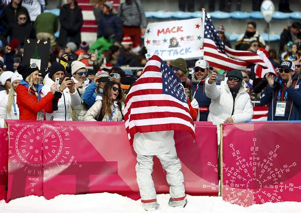 Kyle Mack, of the United States, celebrates after winning the silver medal in the men's Big Air snowboard competition at the 2018 Winter Olympics in Pyeongchang, South Korea, Saturday, Feb. 24, 2018.