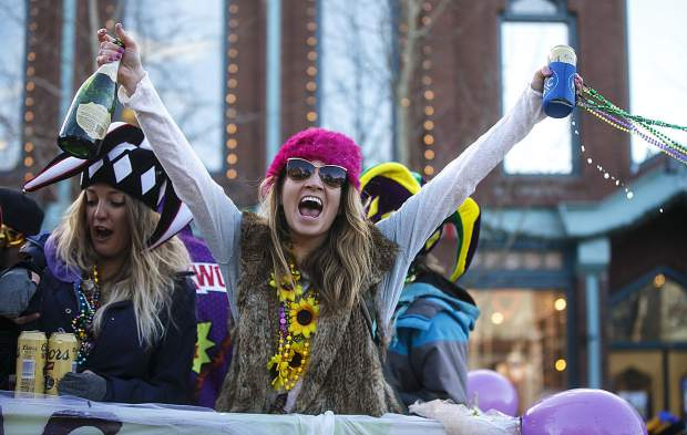 In spirit of the Mardi Gras parade, people celebrate on Main Street in Breckenridge Tuesday, Feb. 13.