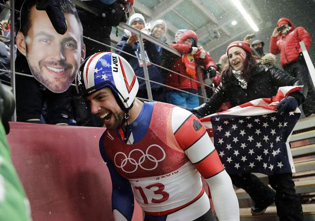 Chris Mazdzer of United States celebrates his silver medal win during final heats of the men's luge competition at the 2018 Winter Olympics in Pyeongchang, South Korea on Sunday, Feb. 11.