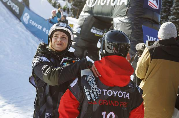 France's Marie Martinod, far left, hugs Kexin Zhang, of China, following the halfpipe finals during the U.S. Grand Prix World Cup event Friday, Dec. 8 at Copper Mountain. Martinod won the event with a score of 83.00 and is a favorite in the Olympics' halfpipe competition in South Korea.