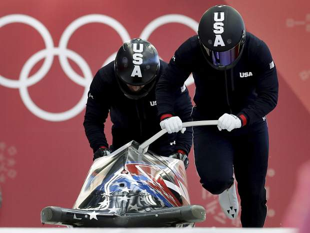 Driver Nick Cunningham and Hakeem Abdul-Saboor of the United States start a two-man bobsled training run at the 2018 Winter Olympics in Pyeongchang, South Korea on Saturday, Feb. 17.