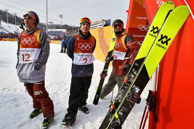 From left; silver medal winner Nick Goepper, of the United States, gold medal winner Oystein Braaten, of Norway, front, and bronze medal winner Alex Beaulieu-Marchand, of Canada, watch the final run during the men's slopestyle final at Phoenix Snow Park at the 2018 Winter Olympics in Pyeongchang, South Korea on Sunday, Feb. 18.