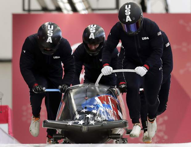 Driver Nick Cunningham, Hakeem Abdul-Saboor, Christopher Kinney, Samuel Michner of the United States start a training run for the four-man bobsled competition at the 2018 Winter Olympics in Pyeongchang, South Korea on Wednesday, Feb. 21.