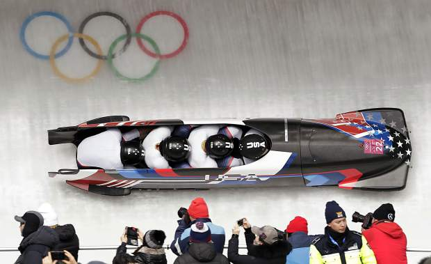 Driver Nick Cunningham, Hakeem Abdul-Saboor, Christopher Kinney, Samuel Michner of the United States take a curve in the second heat of the four-man bobsled competition at the 2018 Winter Olympics in Pyeongchang, South Korea on Saturday, Feb. 24, 2018.