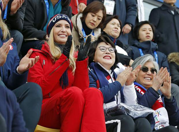 Ivanka Trump, left, sits with Kim Jung-sook, wife of South Korean President Moon Jae-in, and South Korean Foreign Minister Kang Kyung-wha, right, during the men's Big Air snowboard competition at the 2018 Winter Olympics in Pyeongchang, South Korea on Saturday, Feb. 24, 2018.