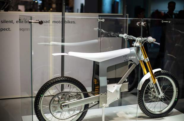 A rear view of the Kalk, the debut 150-pound motorbike from the Swedish brand CAKE, on display. The lightweight carbon body, aluminum frame bike has no gears or a tailpipe thanks to its electric motor and swappable lithium battery