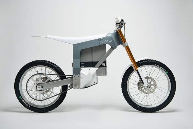 A profile view of the Kalk, the debut 150-pound motorbike from the Swedish brand CAKE. The lightweight carbon body, aluminum frame bike has no gears or a tailpipe thanks to its electric motor and swappable lithium battery.