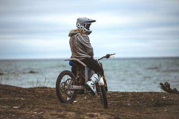 A rider sits atop the debut 150-pound motorbike from the Swedish brand CAKE, the Kalk. The lightweight carbon body, aluminum frame bike has no gears or a tailpipe thanks to its electric motor and swappable lithium battery.