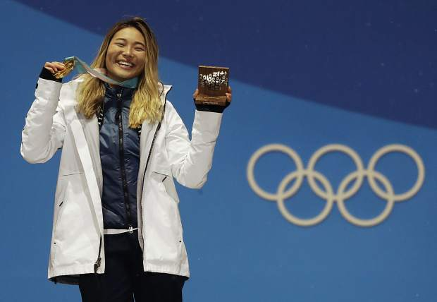 Women's halfpipe gold medalist Chloe Kim, of the United States, poses during the medals ceremony at the 2018 Winter Olympics in Pyeongchang, South Korea, Tuesday, Feb. 13, 2018.