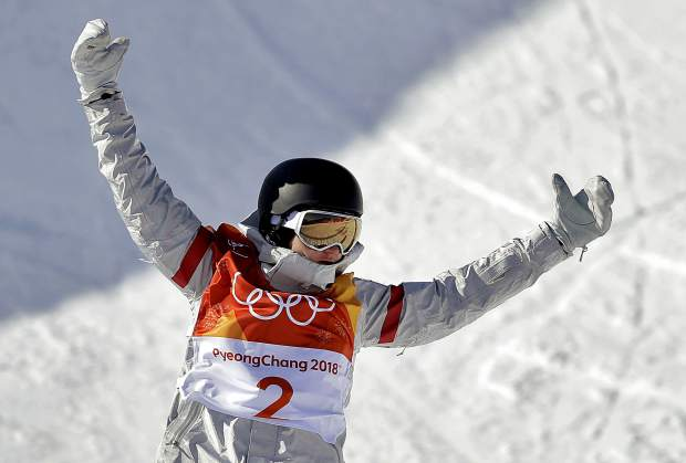 Kelly Clark, of the United States, reacts after finishing during the women's halfpipe finals at Phoenix Snow Park at the 2018 Winter Olympics in Pyeongchang, South Korea, Tuesday, Feb. 13, 2018.
