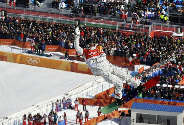 Kelly Clark, of the United States, jumps during the women's halfpipe finals at Phoenix Snow Park at the 2018 Winter Olympics in Pyeongchang, South Korea, Tuesday, Feb. 13, 2018.