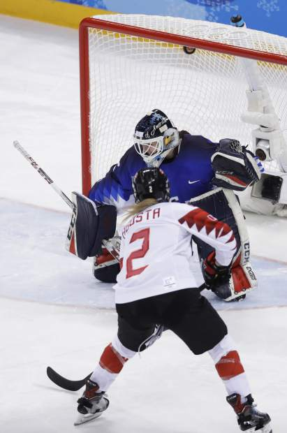 Meghan Agosta (2), of Canada, scores a goal past goalie Maddie Rooney (35), of the United States, in the penalty shootout during the women's gold medal hockey game at the 2018 Winter Olympics in Gangneung, South Korea, Thursday, Feb. 22, 2018. (AP Photo/Matt Slocum)