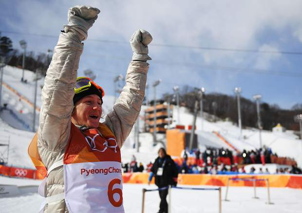The wait is over. Silverthorne's Red Gerard throws up his arms after winning gold in Sunday's snowboard slopestyle competition at the 2018 Winter Olympics at Bokwang Phoenix Park in South Korea.