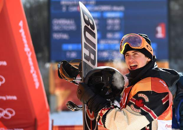 Mark McMorris waits for his score after the third run of the 2018 Winter Olympics men's slopestyle snowboard competition.