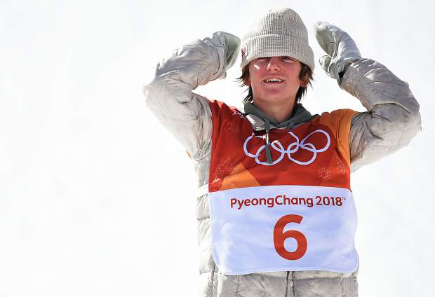 Red Gerard looks out at the crowd after winning a gold medal Sunday in the men's snowboard slopestyle event at the 2018 Winter Olympics.