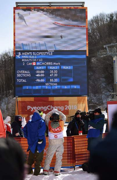 Red Gerard watches at Mark McMorris takes his final run Sunday at the 2018 Winter Olympics. McMorris was the last rider who had a chance to unseat Gerard from the top spot, but he came up just short, placing second.