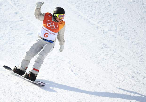 Red Gerard throws up his hand after landing his final trick during his third run at the 2018 Winter Olympics in the men's snowboard slopestyle competition.
