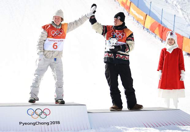 Silverthorne's Red Gerard exchanges a high five with Canada's Mark McMorris on Sunday as the two stood on the podium of an awards ceremony immediately following the event. Gerard won gold and McMorris bronze.