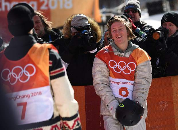 Red Gerard trades a look with Canada's Max Parrot a moment after Parrot's final score was announced, placing him just behind Gerard on the podium. Gerard won the event, claiming the first United States gold medal of the 2018 Winter Olumpics.
