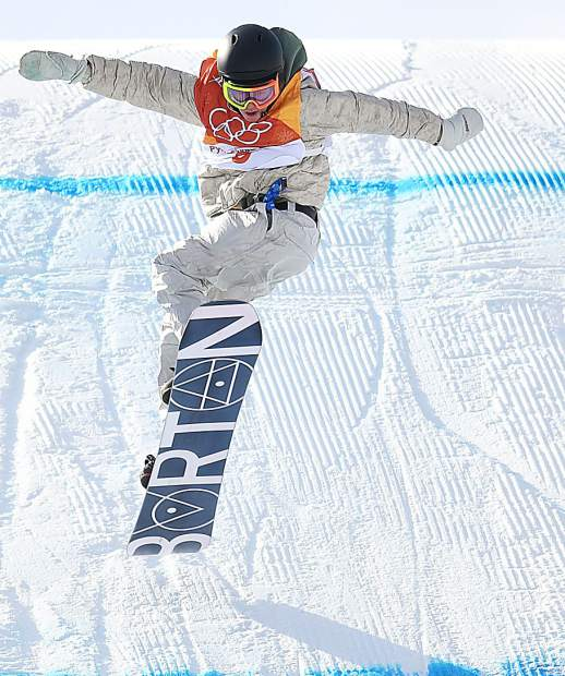 Red Gerard looks down to land his final trick on his last run of the snowboard slopestyle competition Sunday at the 2018 Winter Olympics.
