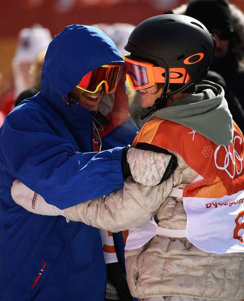 Red Gerard, right, celebrates after winning a gold medal in snowboard slopestyle at the 2018 Winter Olympics.