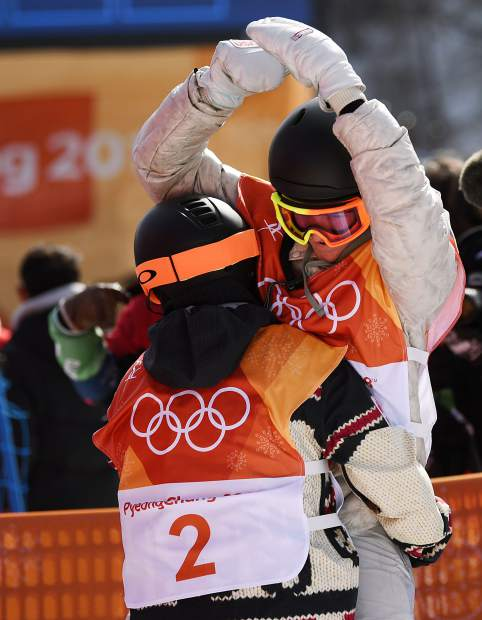 Mark McMorris, 2, celebrates with Red Gerard after it became clear Gerard would medal in snowboard slopestyle at the 2018 Winter Olympics. McMorris won bronze and Gerard gold.