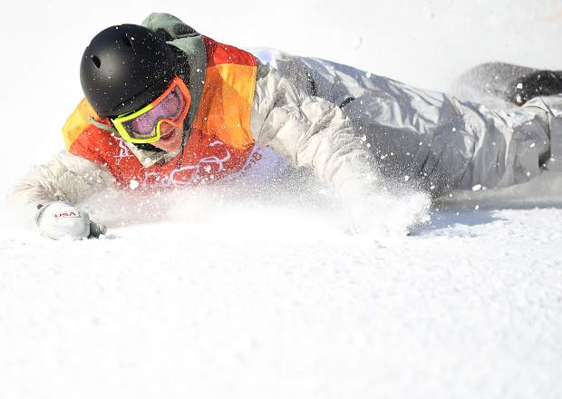 Red Gerard takes a celebratory slide through the snow after landing his final run in the snowboard slopestyle competition at the 2018 Winter Olympics. The run was good enough to win him the gold medal.
