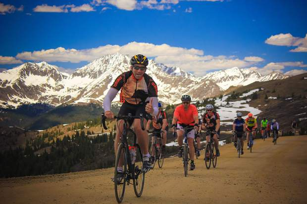 Cyclists pose for the camera while taking part in the Ride The Rockies.