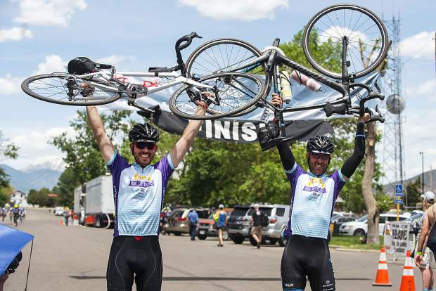 Cyclists hoist up their bikes at the Ride The Rockies race.