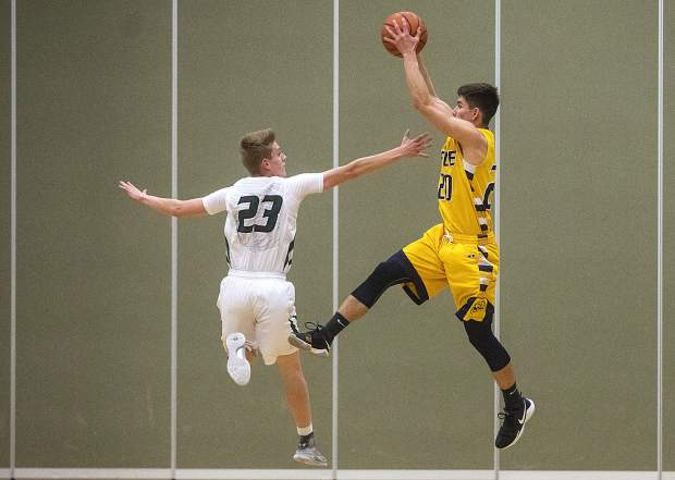 Summit High School junior Wyatt Buller defends against Rifle High School junior Joel Lopez during the home game Thursday, Feb. 8, in Frisco.
