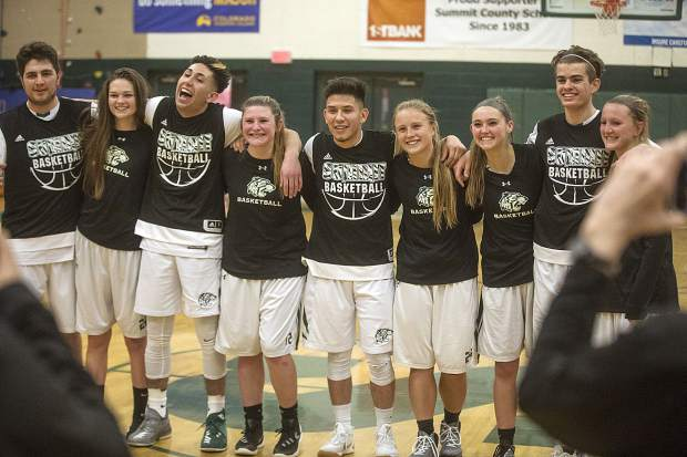 Summit High School seniors pose for a photo in a ceremony during the home game against Rifle High School Thursday, Feb. 8, in Frisco.