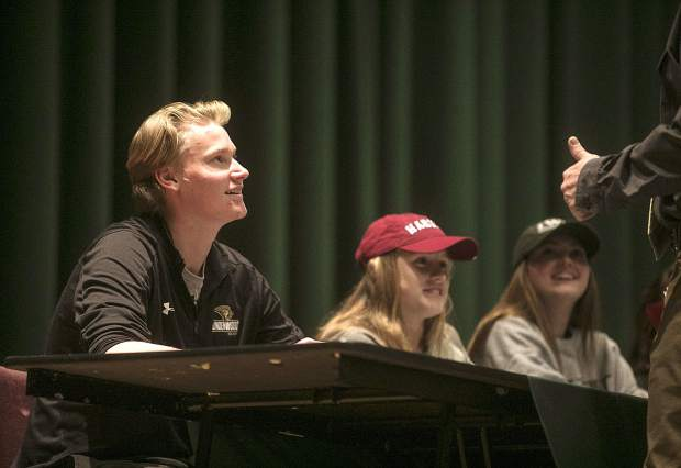 Summit High hockey standout Sean Gurlea (far left) smiles during Wednesday's National Signing Day ceremony at the high school's auditorium. Gurlea will attend Lindenwood University.
