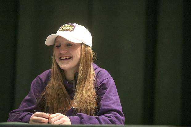 Summit High student-athlete Haleigh Lecklitner smiles at the school's annual National Signing Day ceremony on Wednesday at the high school's auditorium. Lecklitner will play soccer at Knox College.