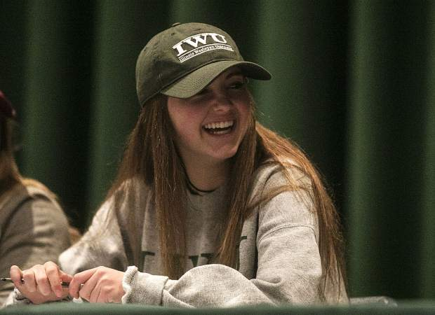 Summit High student-athlete Shannon Hogeman smiles at the school's annual National Signing Day ceremony. Hogeman will play soccer next year at Illinois Wesleyan University.
