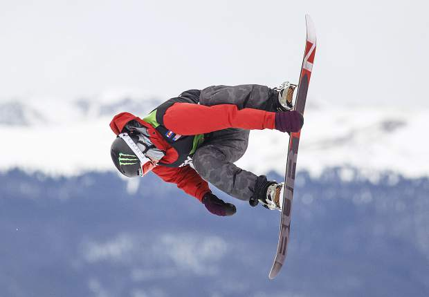 Silverthorne resident Chris Corning of the United States grabs his snowboard during the Dew Tour Slopestyle finals at Breckenridge Ski Resort in December, an event that was crucial to Corning's Olympic qualification.