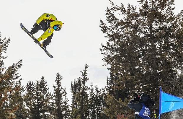 Kyle Mack grabs off the hip hit during the X Games Aspen slopestyle qualifiers last month.