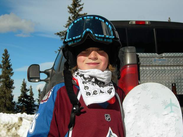 Nine-year-old Chris Corning wears a Colorado Avalanche jersey for a day out on the slopes, half-a-lifetime ago for the 18-year-old Silverthorne snowboarder who will make his Olympic debut Friday.