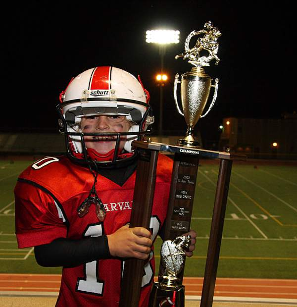 A decade before he qualified for the Pyeongchang Olympics at the age of 18, eight-year-old Chris Corning was also a young star on the football fields down in Arvada, seen here hoisting the Carnation Bowl trophy.
