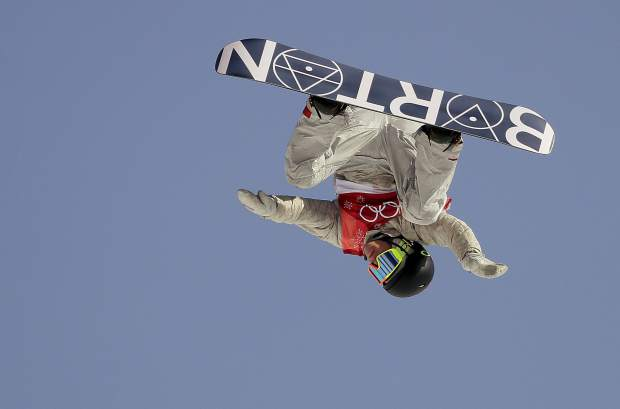 Redmond Gerard, of the United States, jumps during the men's big air snowboard qualification competition at the 2018 Winter Olympics in Pyeongchang, South Korea, Wednesday, Feb. 21, 2018.