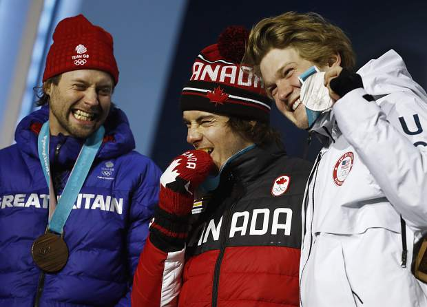 Medalist in the Big Air snowboard competition from right, United States' Kyle Mack, silver, Canada's Sebastien Toutant, gold, and Britain's Billy Morgan, bronze, celebrate during their medals ceremony at the 2018 Winter Olympics in Pyeongchang, South Korea, Saturday, Feb. 24, 2018.