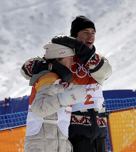 Gold medal winner Red Gerard, of the United States, left, and bronze medal winner Mark McMorris, of Canada, embrace after the men's slopestyle final at Phoenix Snow Park at the 2018 Winter Olympics in Pyeongchang, South Korea, Sunday, Feb. 11, 2018.