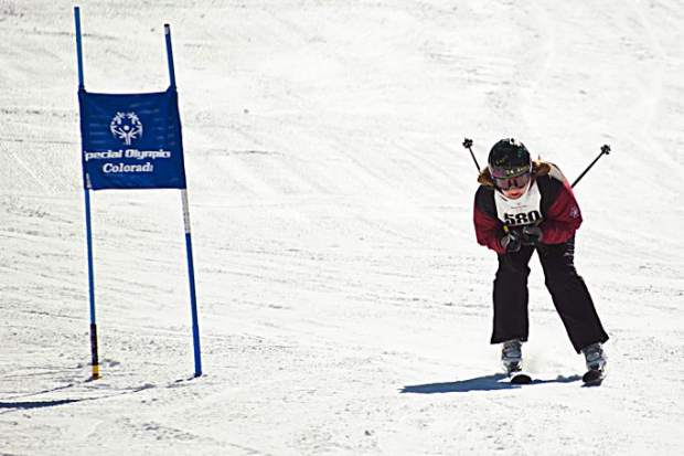 A Special Olympics athlete tucks while skiing at the Special Olympics Colorado Winter Games at Copper Mountain Resort.