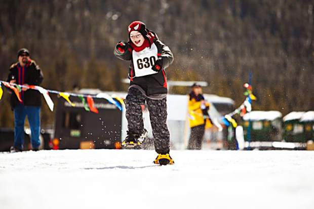 A Special Olympics competitor runs in snowshoes at the Special Olympics Colorado Winter Games at Copper Mountain Resort.