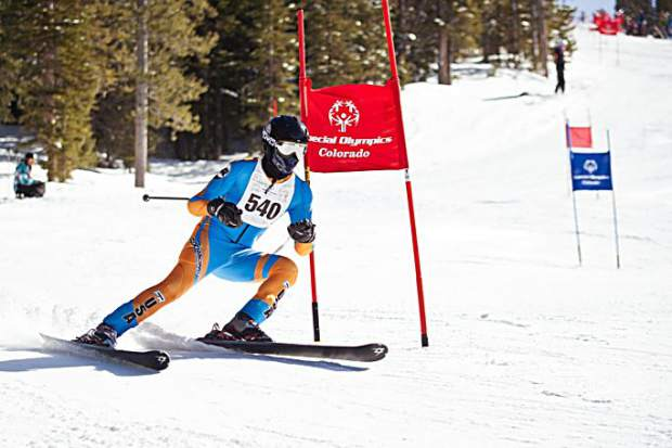 A Special Olympics competitor weaves outside a course gate at the Special Olympics Colorado Winter Games at Copper Mountain Resort.