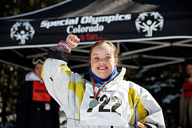 A silver medal winner raises her arm in celebration at the Special Olympics Colorado Winter Games at Copper Mountain Resort.