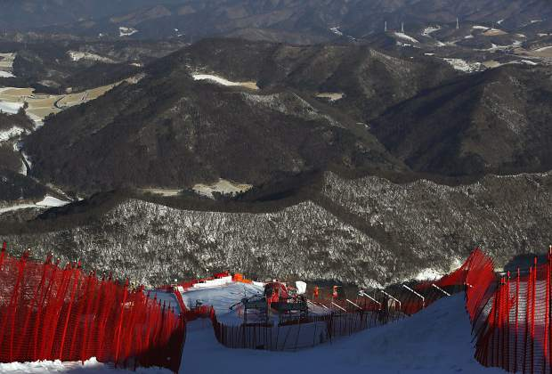 A view from the start hut after the women's giant slalom was postponed due to high winds at the 2018 Winter Olympics at the Yongpyong Alpine Center, Pyeongchang, South Korea, Monday, Feb. 12, 2018. (AP Photo/Alessandro Trovati)