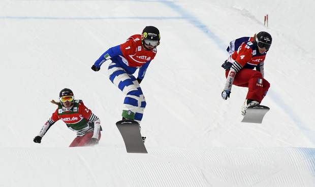 From left: France's Chloe Trespeuch, Italy's Michela Moioli and France's Charlotte Bankes compete during the women's snowboard-cross World Cup final race at Feldberg Mountain, Germany, Sunday, Feb.4, 2018. (Patrick Seeger/dpa via AP)