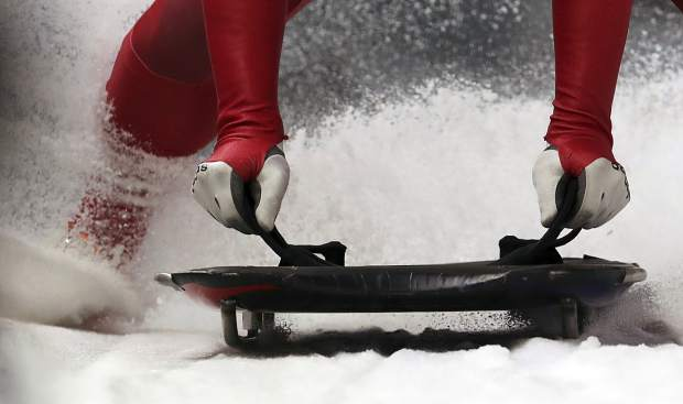 Jisoo Kim of South Korea brakes in the finish area during the men's skeleton training session at the 2018 Winter Olympics in Pyeongchang, South Korea on Wednesday, Feb. 14.