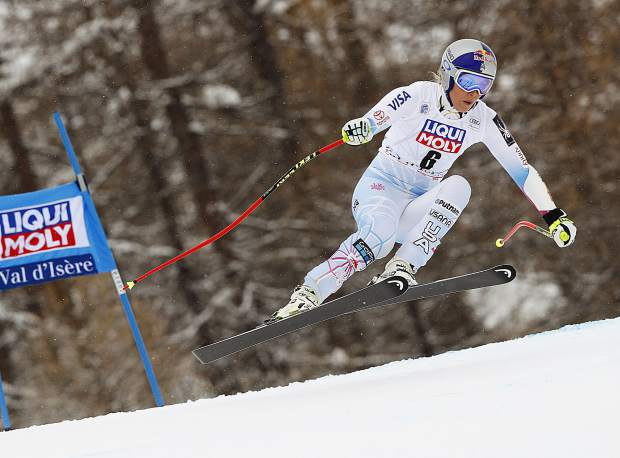 In this Dec. 16, 2017, file photo, United States skier Lindsey Vonn competes during a women's World Cup super-G race in Val d'isere, France. Vonn has some unfinished business on her agenda as she heads to the Pyeongchang Olympics. That includes trying to win more medals after missing the last Olympics because of a bad knee.